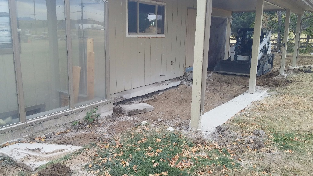 Look at the gap under the old patio.